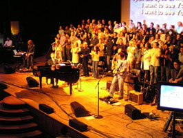 The crowded stage of Sunday Evening Worship